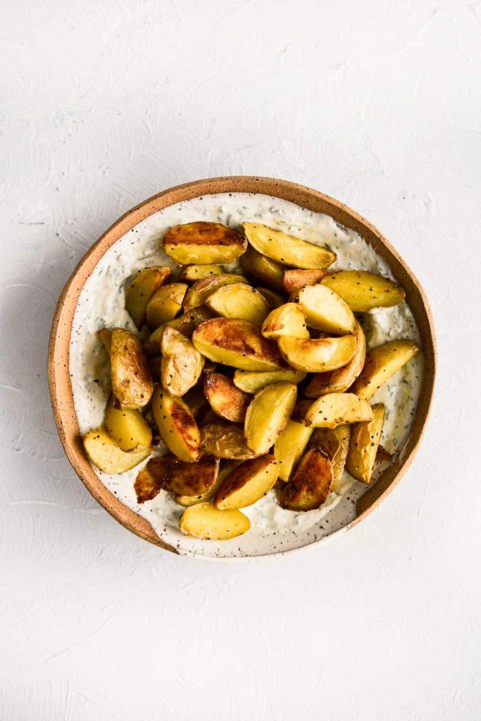 Roasted Potatoes with Herby Tahini Greek Yogurt