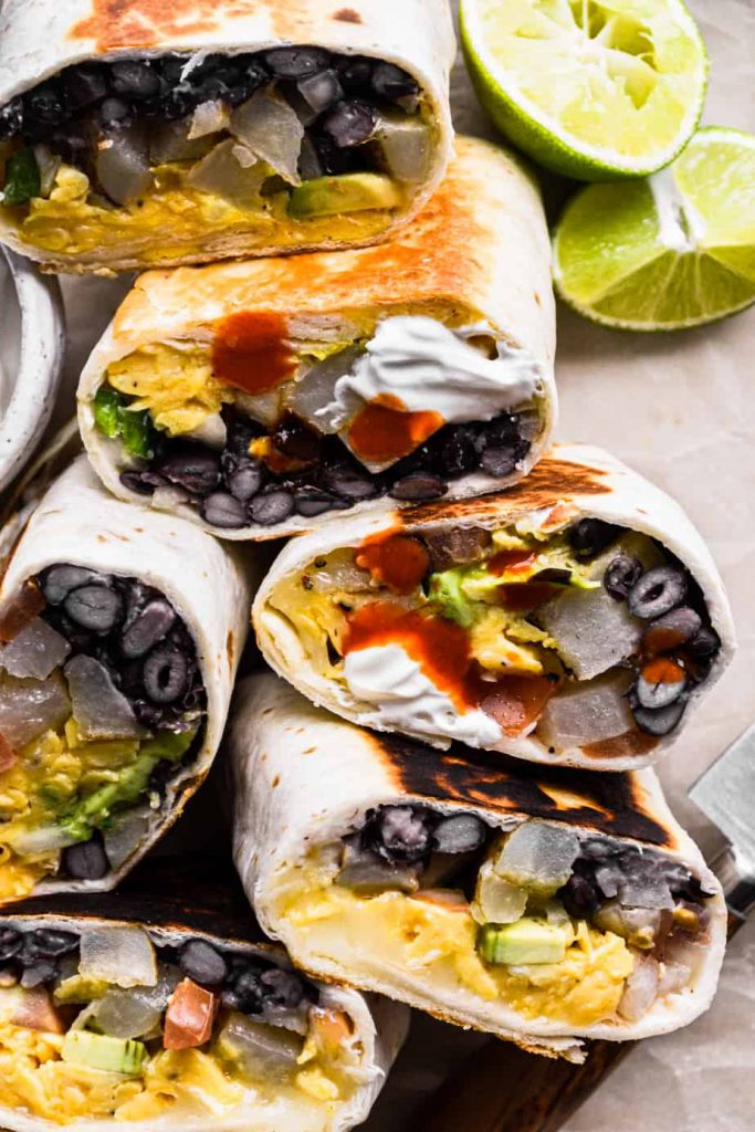 Vegetarian Breakfast Burritos with hot sauce and sour cream