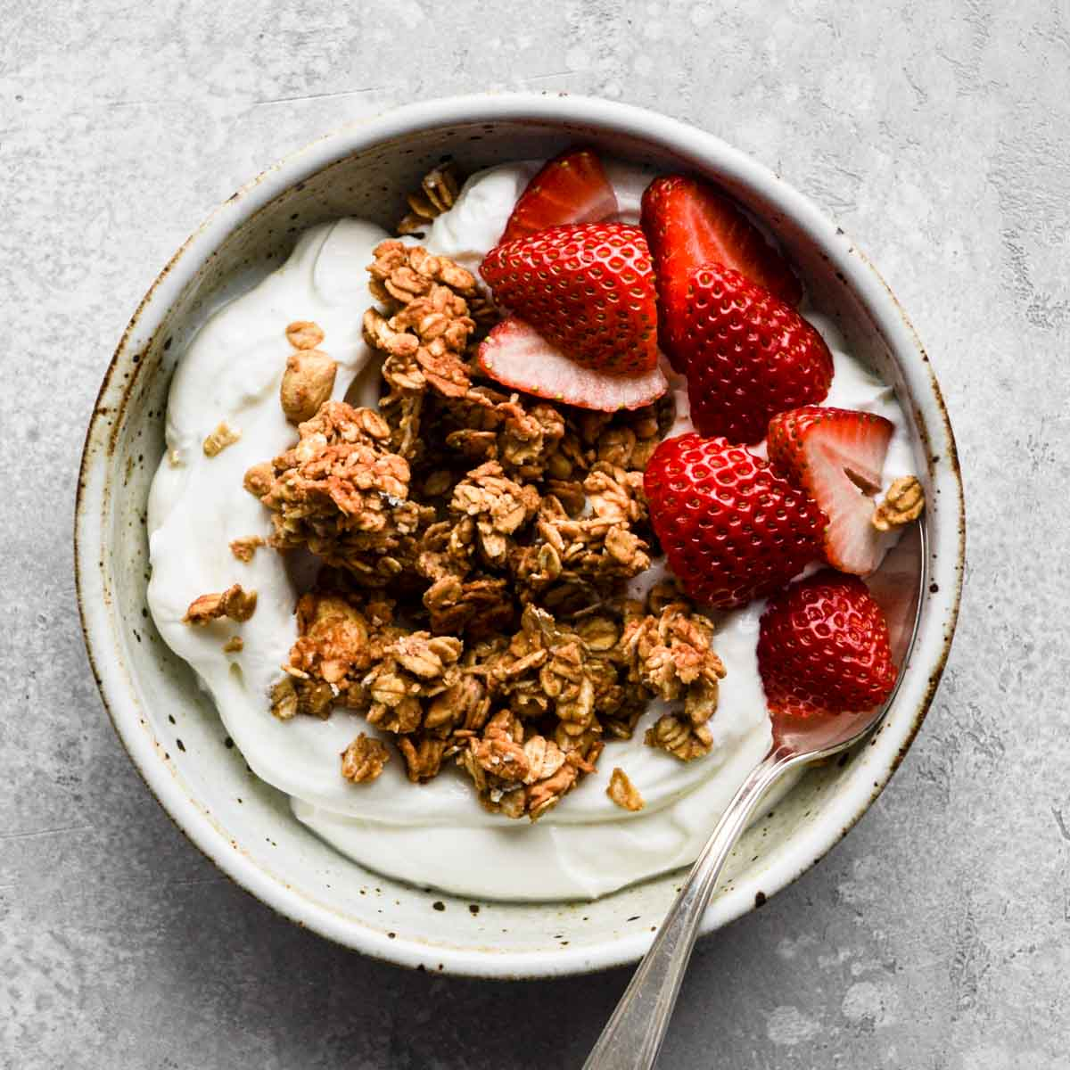 Granola in a bowl with yogurt and strawberries