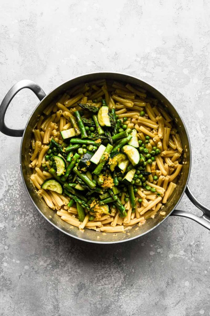 Cooked vegetables over the pasta