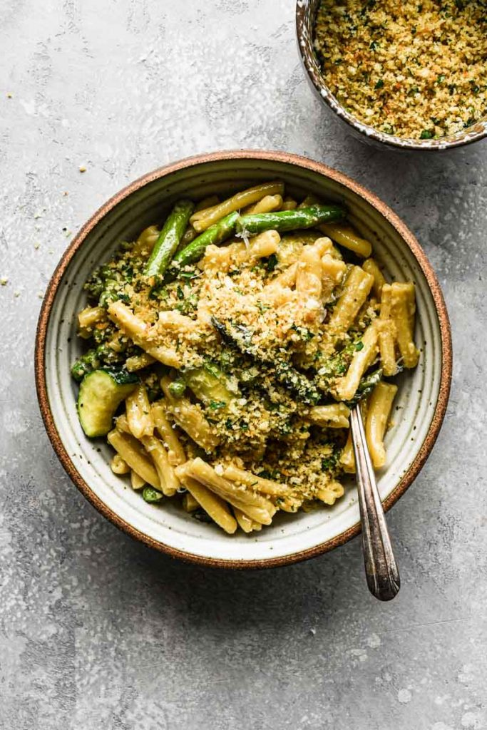 Creamy Spring Vegetable Pasta with breadcrumbs on top