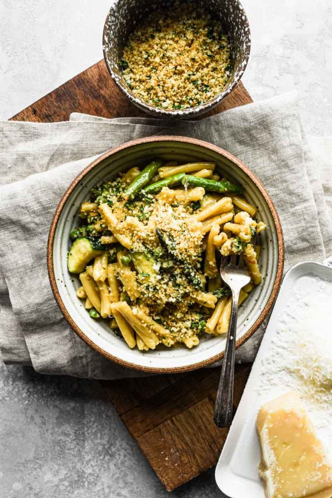 Creamy Spring Vegetable Pasta on wood board