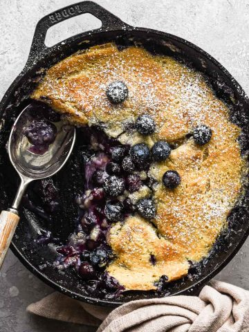 Up close of finished blueberry cobbler