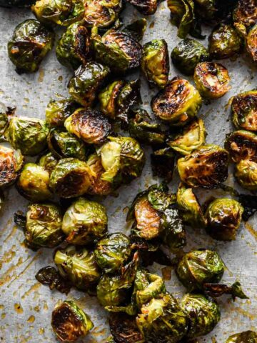 Thumbnail image of honey sriracha brussels sprouts on a sheet tray.
